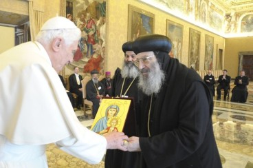 Pope Benedict XVI exchanges gifts with members of the Eastern Orthodox Church during a meeting at the Vatican January 28, 2011. REUTERS/Osservatore Romano (VATICAN - Tags: RELIGION) THIS IMAGE HAS BEEN SUPPLIED BY A THIRD PARTY. IT IS DISTRIBUTED, EXACTLY AS RECEIVED BY REUTERS, AS A SERVICE TO CLIENTS