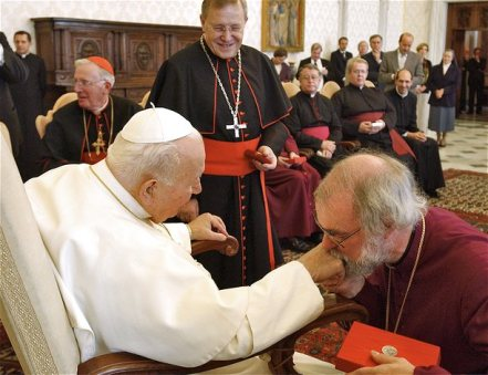 Pope John Paul II is kissed by the Archibishop of Canterbury Dr. Rowan Williams during a private audience in his library at the Vatican, October 4, 2003. REUTERS/Vatican/Handout